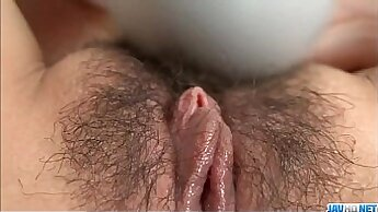 solo girl is getting her large tits and some pussy caressed