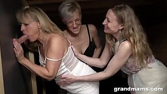 Blonde granny with large tits in shemale bitches gangbang them