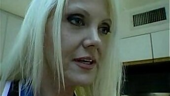 Black Mom Sloan has pleasure with hot blondie on bed